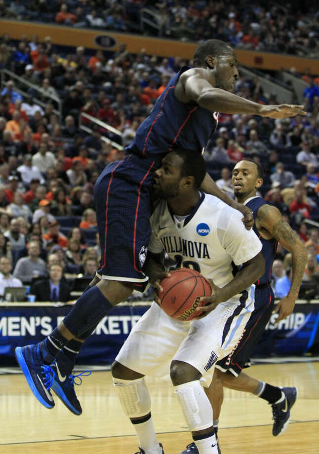 Villanova's JayVaughn Pinkston (22) is fouled by UConn's Terrence Samuel (3) during the first half of the third-round game in the men's NCAA college basketball tournament at the First Niagara Center, Saturday, March 22, 2014. (AP Photo/The Buffalo News, Harry Scull Jr.)