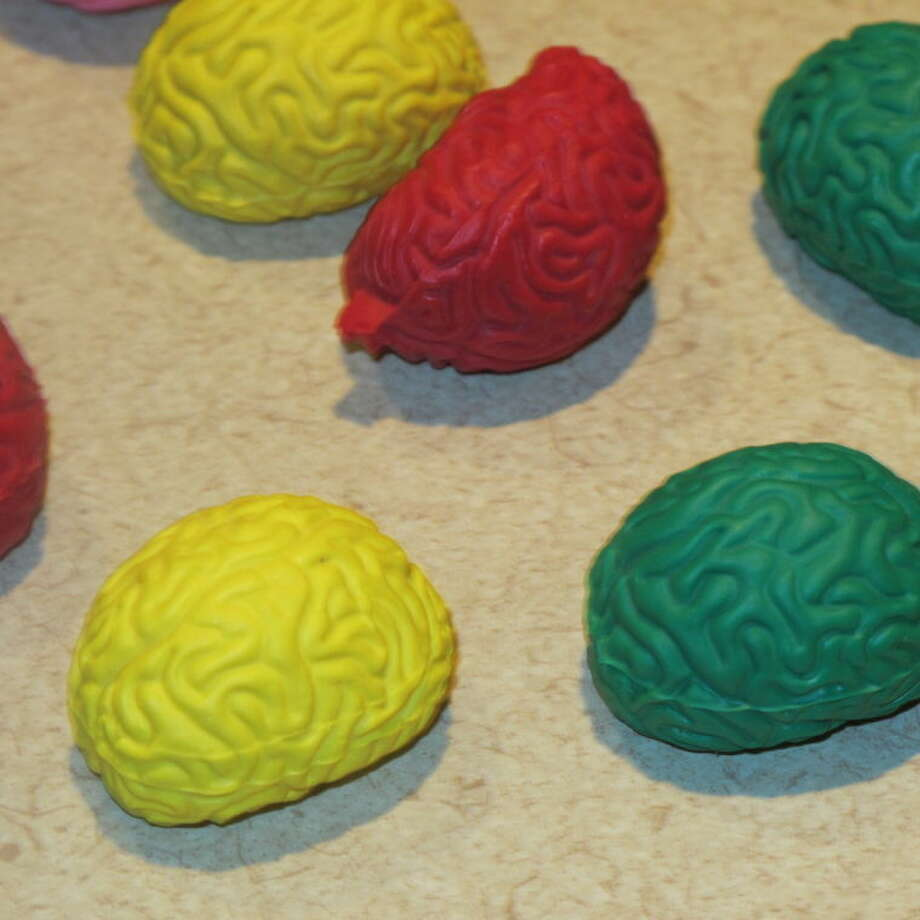 In this Feb. 25, 2014 photo, pencil erasers in the shape of the human brain lie on a table at Montefiore Hospital in the Bronx borough of New York. The erasers were given to third-graders who attended a class that teaches them to recognize stroke and get victims to a hospital quickly. (AP Photo/Jim Fitzgerald)