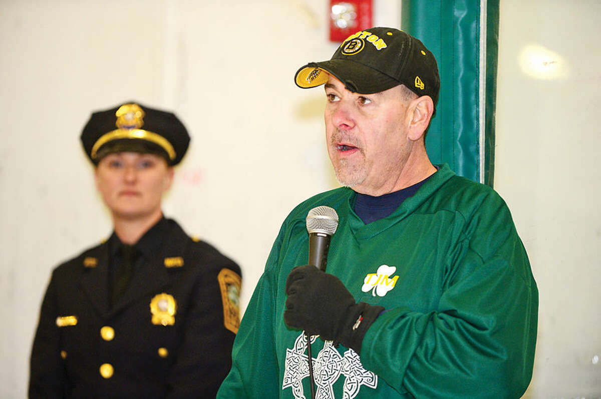 Hour photo / Erik Trautmann Retired Norwalk Police Lt. Tim Murphy thanks the crowd as the Norwalk PoliceUnion holds a benefit hockey game for Murphy Saturday at SoNo Ice House. Murphy was diagnosed with cancer shortly after retiring.