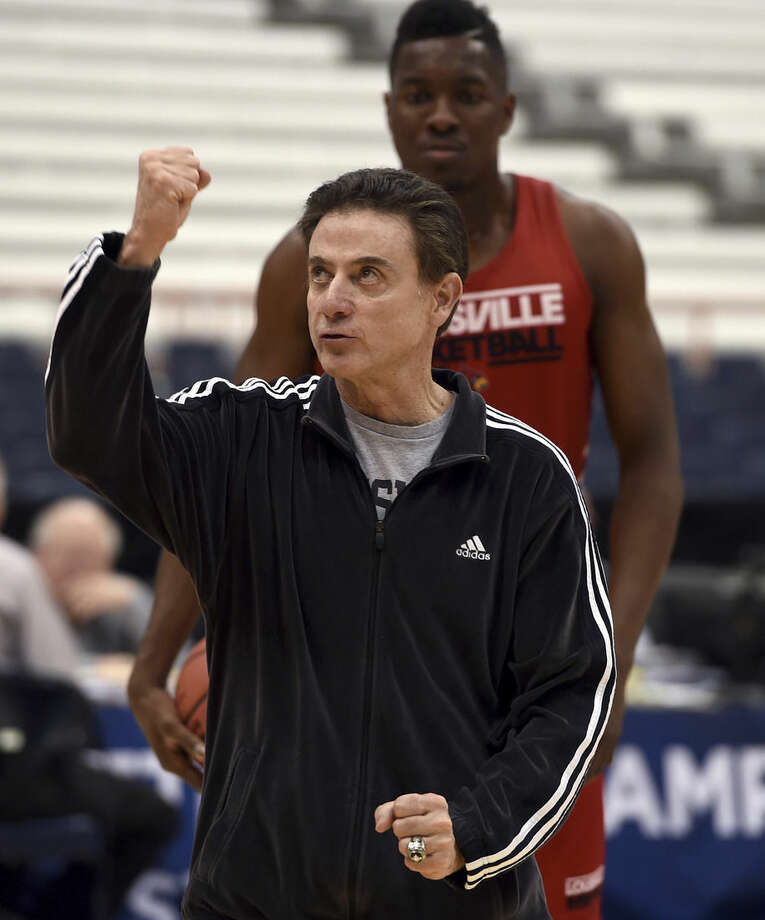 Louisville head coach Rick Pitino instructs his players during practice for an east regional semifinal in the NCAA Tournament, Thursday, March 26, 2015, in Syracuse, N.Y. Louisville will play NC State on Friday. (AP Photo/The Syracuse Newspapers, Kevin Rivoli)