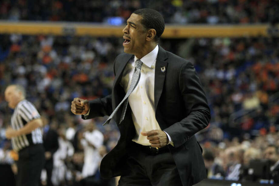 UConn coach Kevin Ollie reacts to a play during the first half of the third-round game in the men's NCAA college basketball tournament at the First Niagara Center, Saturday, March 22, 2014. (AP Photo/The Buffalo News, Harry Scull Jr)