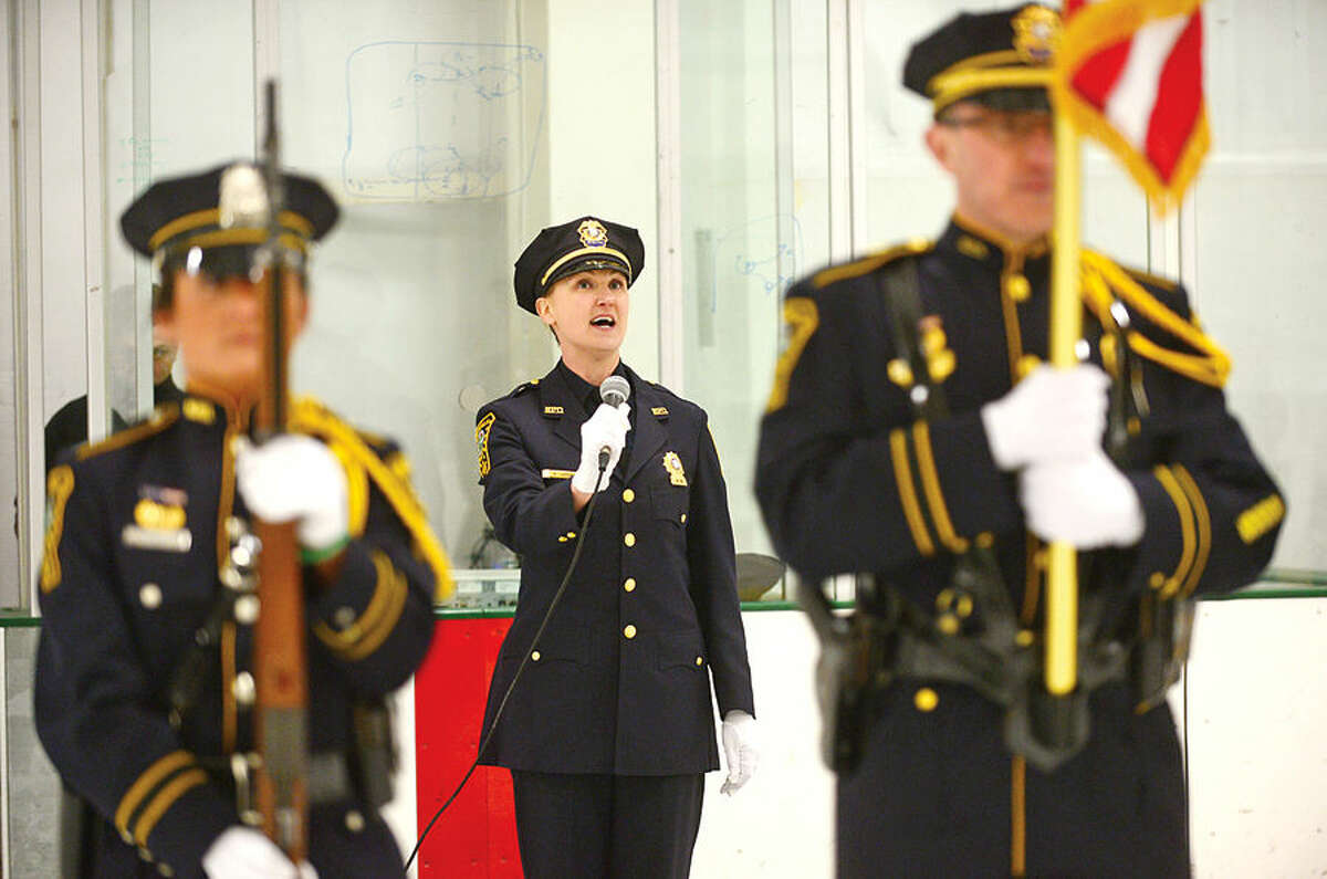 Hour photo / Erik Trautmann Lt. Cristina LePak sings the national anthem as the Norwalk PoliceUnion holds a benefit hockey game for recently retired NPD Lt. Timothy Murphy Saturday at SoNo Ice House.