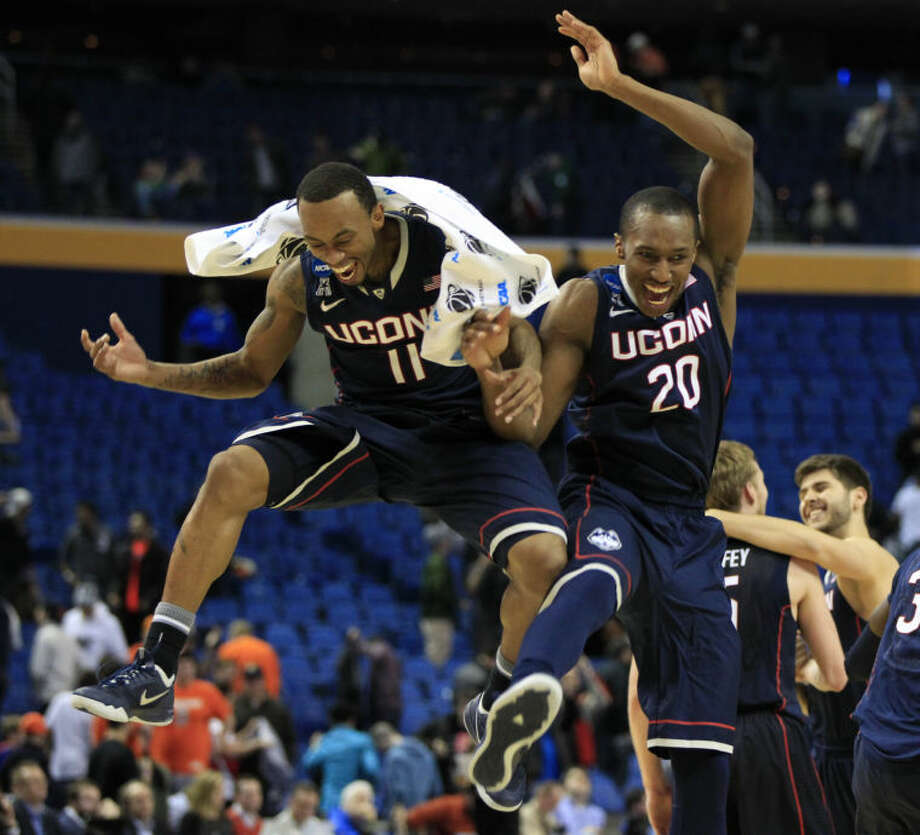 UConn's Ryan Boatright (11) and Lasan Kromah (20) celebrate their team's 77-65 victory over Villanova in the third-round game in the men's NCAA college basketball tournament at the First Niagara Center, Sunday, March 23, 2014. (AP Photo/The Buffalo News, Harry Scull Jr.)