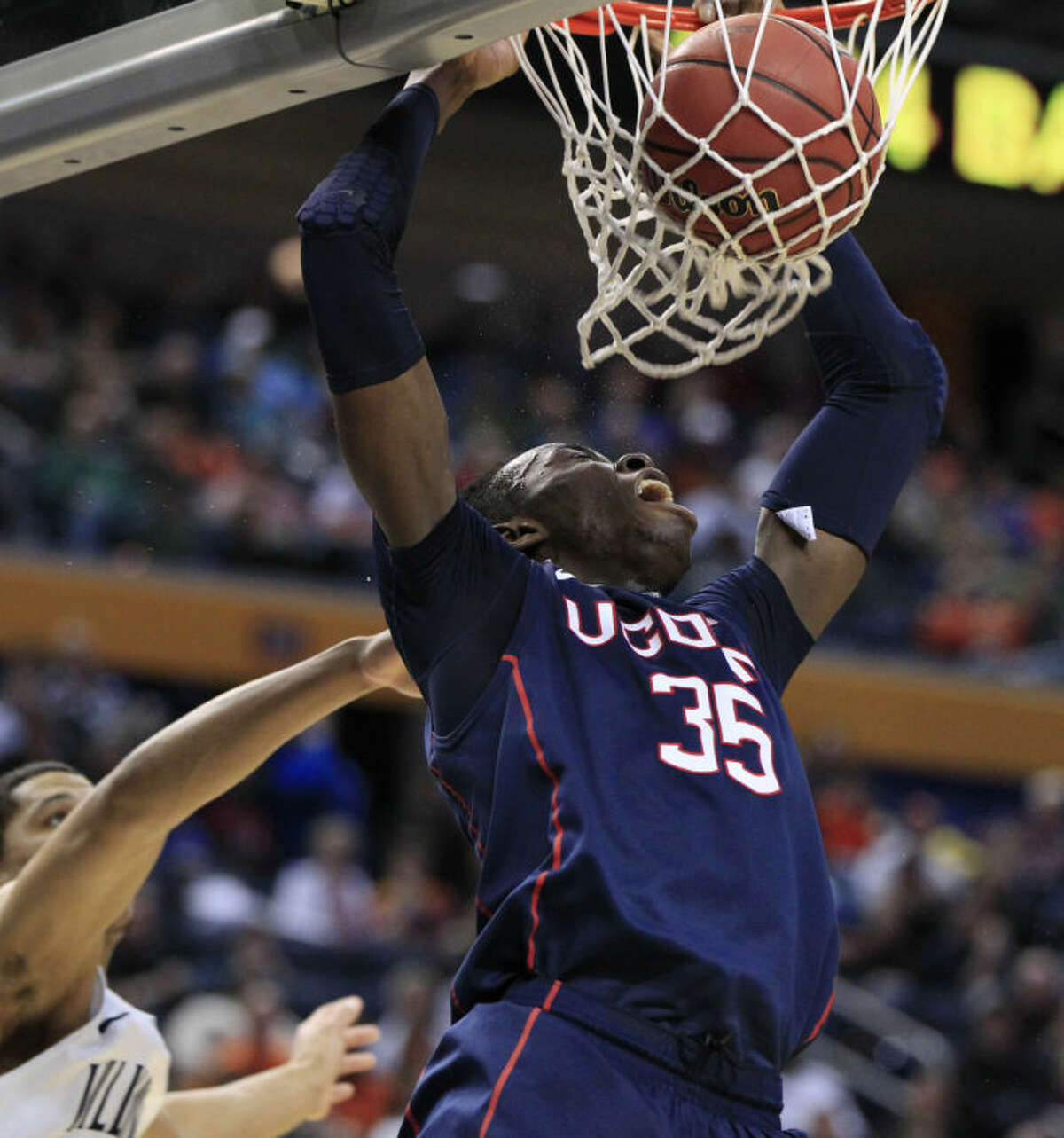UConn's Amida Brimah throws down a dunk against Villanova during the second half of the third-round game in the men's NCAA college basketball tournament at the First Niagara Center, Saturday, March 22, 2014. (AP Photo/The Buffalo News, Harry Scull Jr.)