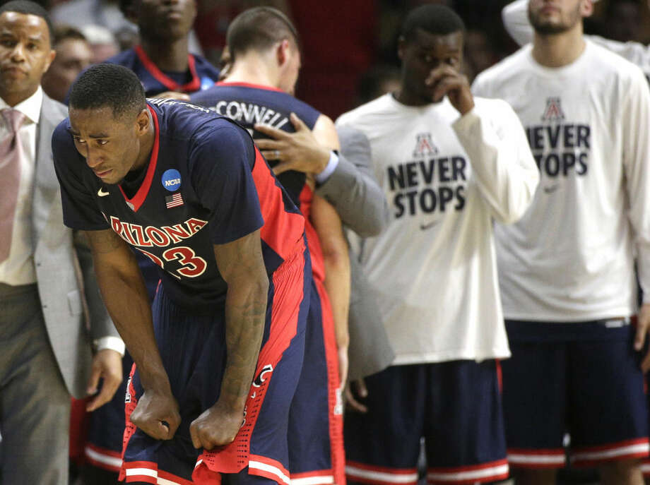 Arizona forward Rondae Hollis-Jefferson reacts near the end of a college basketball regional final against Wisconsin in the NCAA Tournament, Saturday, March 28, 2015, in Los Angeles. Wisconsin beat Arizona 85-78 to advance to the Final Four. (AP Photo/Jae C. Hong)