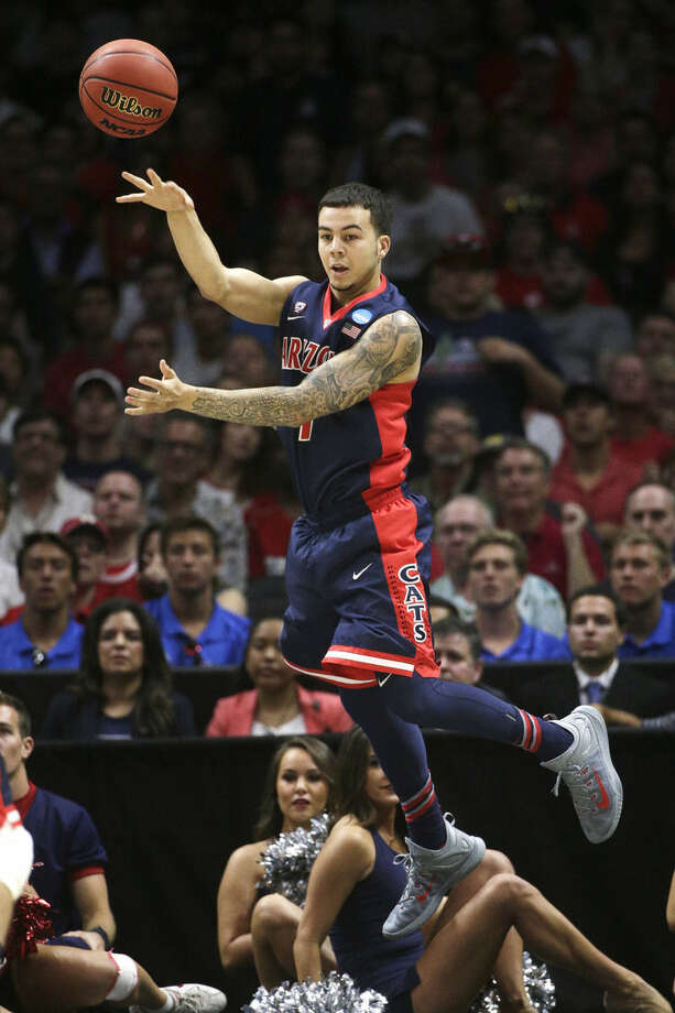 Arizona guard Gabe York tries to keep the ball in-bounds against Wisconsin in the first half of a college basketball regional final in the NCAA Tournament, Saturday, March 28, 2015, in Los Angeles. (AP Photo/Jae C. Hong)