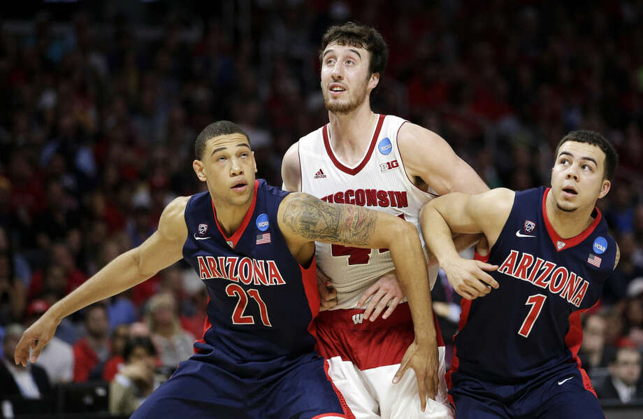 Arizona's Brandon Ashley, left, and Gabe York, right, try to block out Wisconsin forward Frank Kaminsky after a free throw during the second half of a college basketball regional final in the NCAA Tournament, Saturday, March 28, 2015, in Los Angeles. (AP Photo/Jae C. Hong)