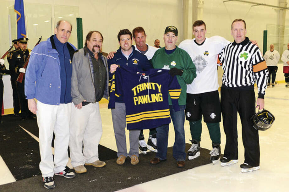 A group from Trinity Pawling hockey program honors Murphy.