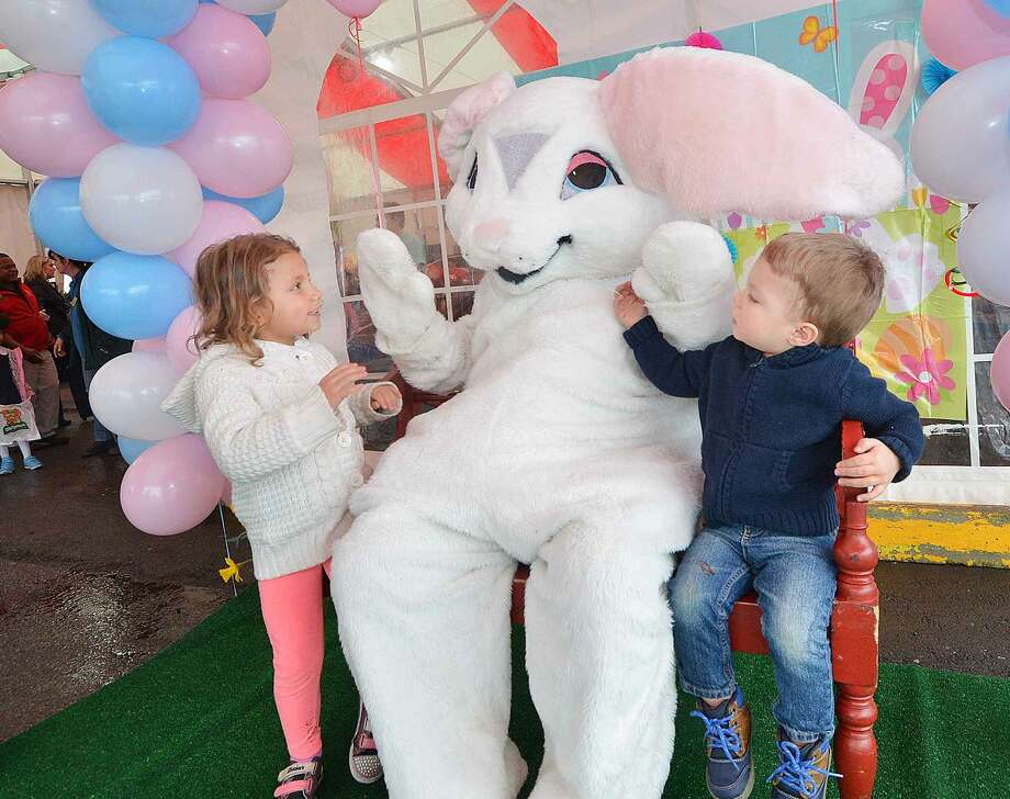 Hour Photo/Alex von Kleydorff 2yr old Sophia Montero and older brother 3yr old Anthony get a chance to meet the Easter Bunny during Stew Leonard's easter egg hunt Eggs-travaganza