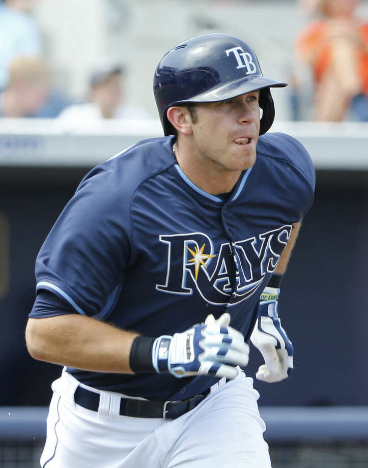 Tampa Bay Rays' Evan Longoria sticks out his tongue as he runs to first base after batting in the fifth inning during an exhibition spring training baseball game against the New York Yankees, Thursday, March 26, 2015, in Port Charlotte, Fla. The Rays won 6-5. (AP Photo/Brynn Anderson)