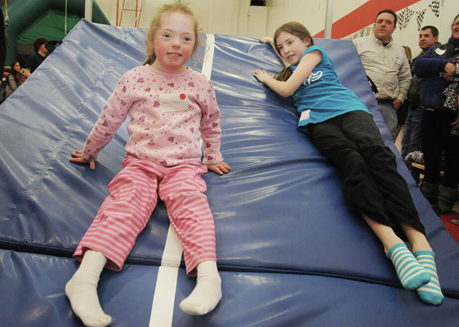Mary Kathryn LLewelyn, 6, with her friend, Carolyn Takacs, enjoy the fourth annual World Down Syndrome Day at the New Canaan YMCA.