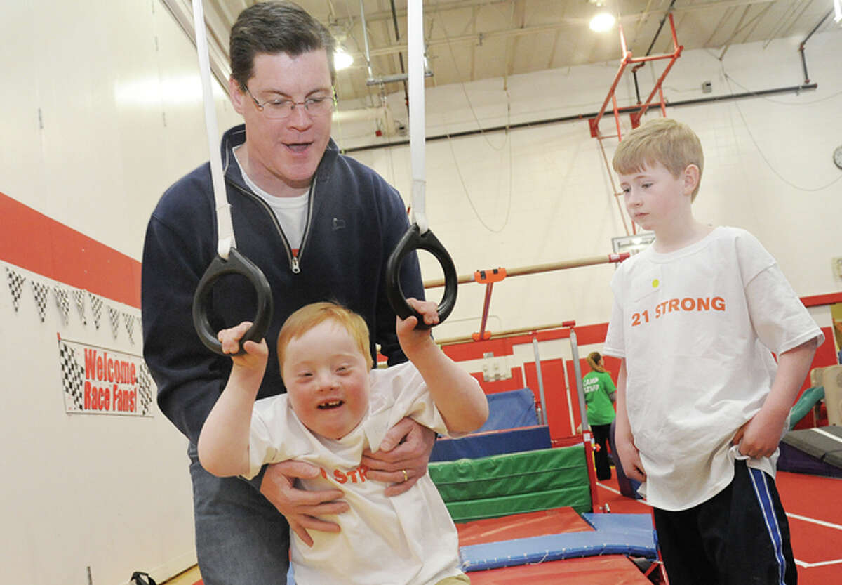 Andrew Bresnahan with his his son Ryan, 7, and older son Colin, 10, Sunday at the New Canaan YMCA for the fourth annual World Down Syndrome Day.