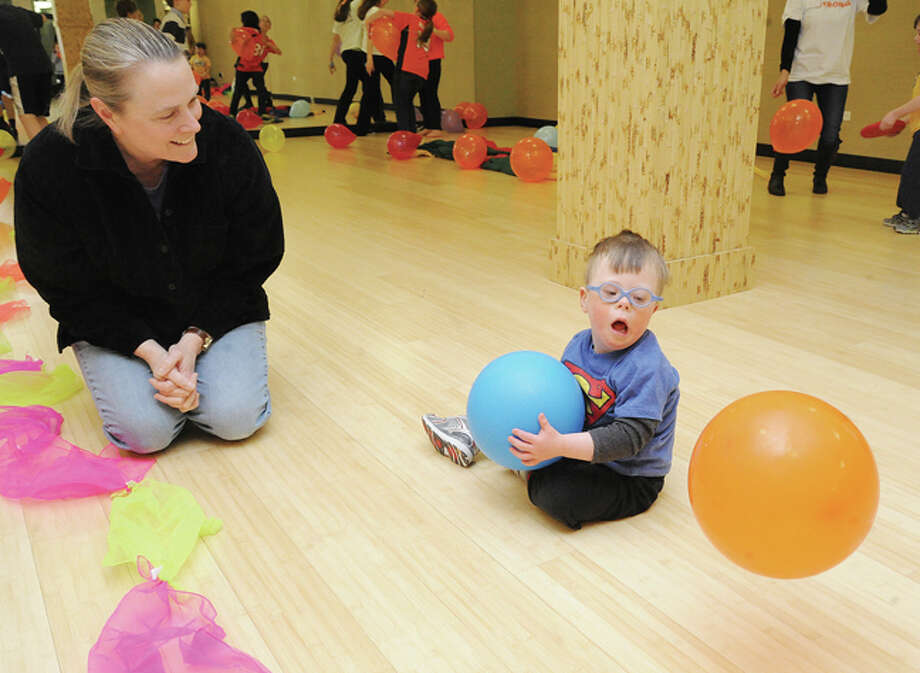 Andee Schanne and her son Robby, 3, Sunday at the New Canaan YMCA for the fourth annual World Down Syndrome Day.