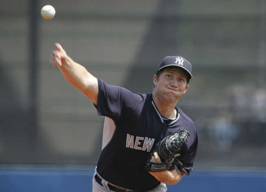New York Yankees pitcher Adam Warren delivers against the Tampa Bay Rays during the first inning during an exhibition spring training baseball game, Thursday, March 26, 2015, in Port Charlotte, Fla. (AP Photo/Brynn Anderson)