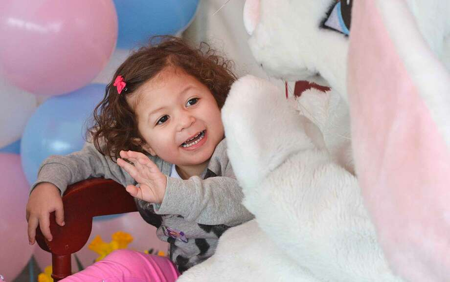 Hour Photo/Alex von Kleydorff 2yr old Amelia Aponte waves goodby to the Easter Bunny after spending a moment for a photo during Stew Leonard's Eggs-travaganza Easter Egg hunt on Thursday