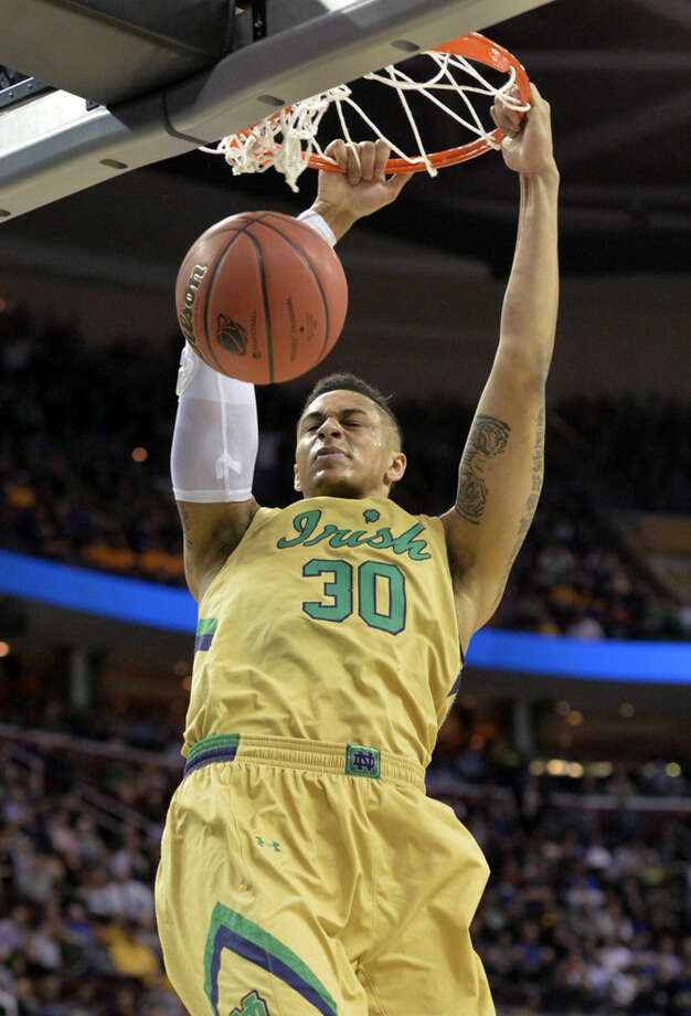 Notre Dame's Zach Auguste dunks against Wichita State in the first half of a college basketball game in the NCAA men's tournament regional semifinals, Thursday, March 26, 2015, in Cleveland. (AP Photo/David Richard)