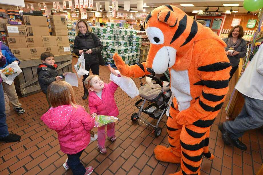 Hour Photo/Alex von Kleydorff Tiger meets the kids as kids comninue on their Easter Egg hunt during Stew Leonard's easter egg hunt Eggs-travaganza