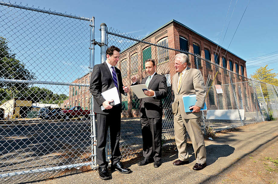 In this file photo, state Rep. Chris Perone, state Senate Majority Leader Bob Duff and Norwalk Mayor Harry Rilling prepare for a press conference to announce the conversion of 2 Merritt Place into housing for the Norwalk Open Door Shelter.