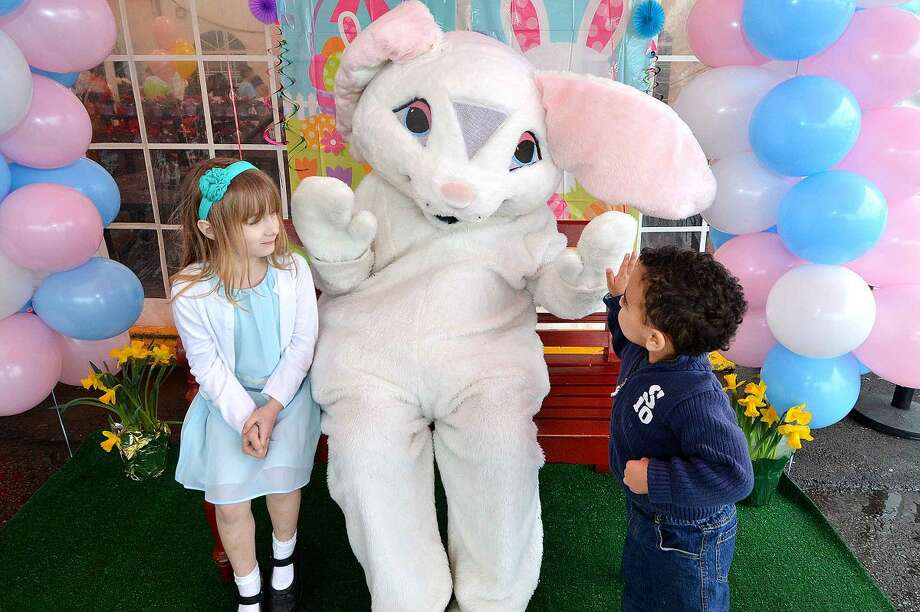 Hour Photo/Alex von Kleydorff 6yr old Casey Utzler and brother 3yr old Jack meet the Easter Bunny at Stew Leonard's easter egg hunt Eggs-travaganza