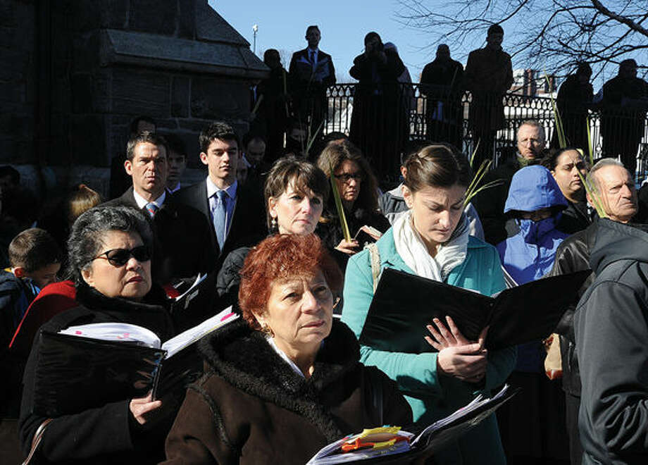 Members of St. Mary Church in Norwalk observe the procession Sunday at the mass on West Avenue. Hour photo/Matthew Vinci