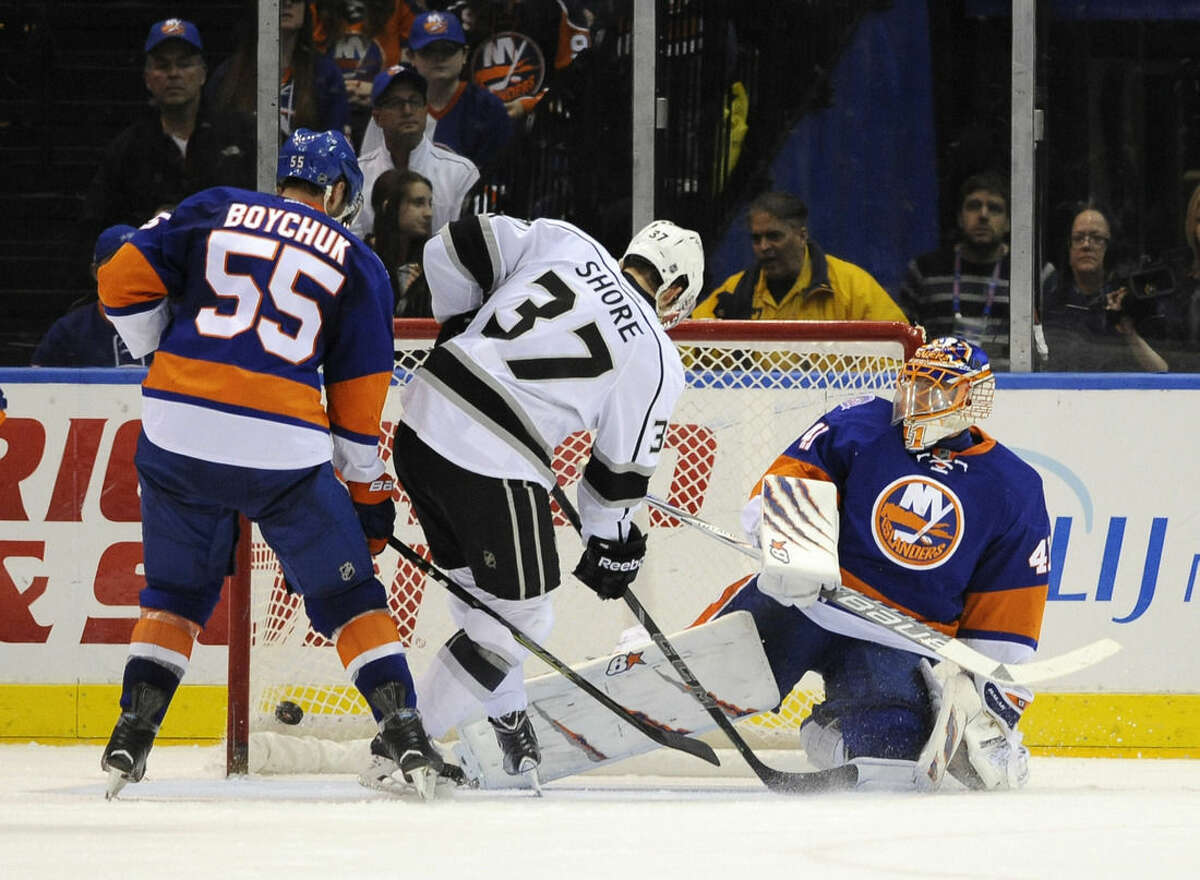 Los Angeles Kings center Nick Shore (37) scores against New York Islanders defenseman Johnny Boychuk (55) and goalie Jaroslav Halak (41) during the second period of an NHL hockey game on Thursday, March 26, 2015, in Uniondale, N.Y. (AP Photo/Kathy Kmonicek)