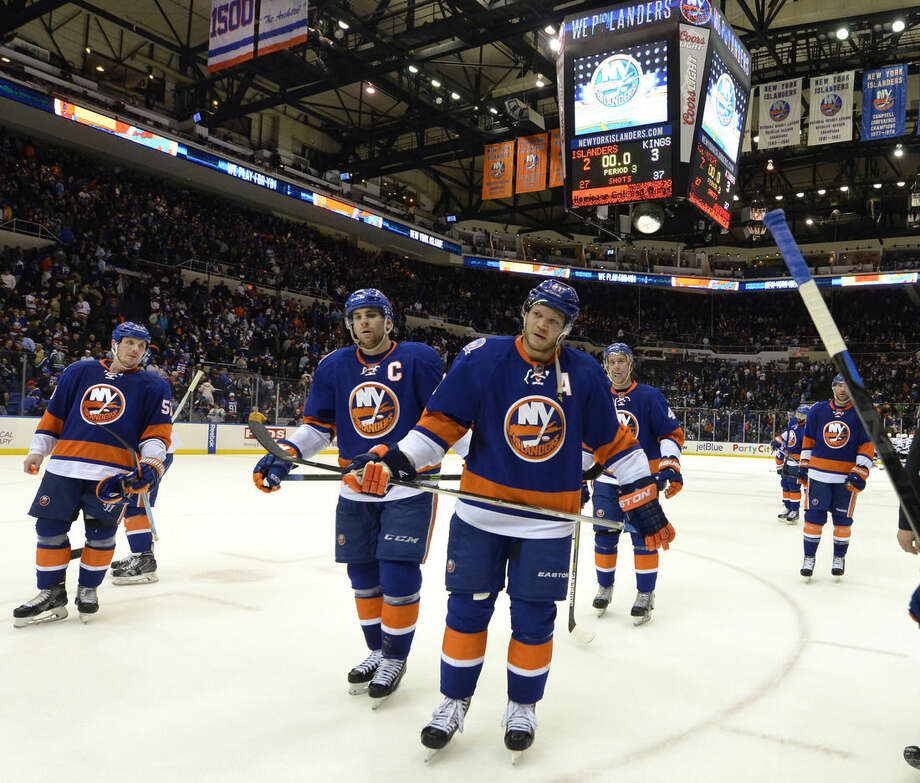 New York Islanders right wing Kyle Okposo (21), center John Tavares (91) and teammates leave the ice after the team's 3-2 loss to the Los Angeles Kings in an NHL hockey game on Thursday, March 26, 2015, in Uniondale, N.Y. The Kings won 3-2. (AP Photo/Kathy Kmonicek)