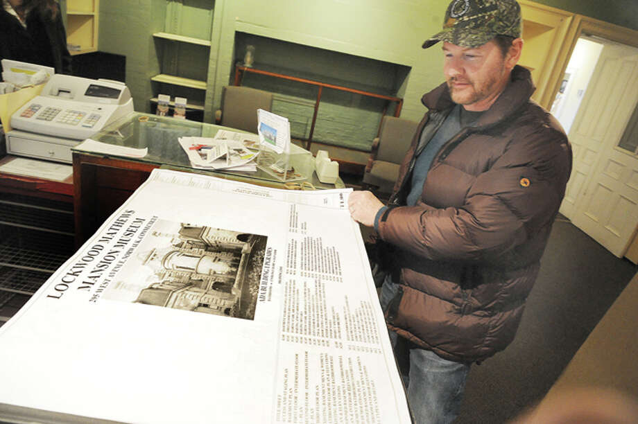David Westmooreland, Chairman of the Norwalk Historical Commision with drawings of the proposed work for the Lockwood Mathews Mansion that will include an elevator and new bathroom facilities. Hour photo/Matthew Vinci