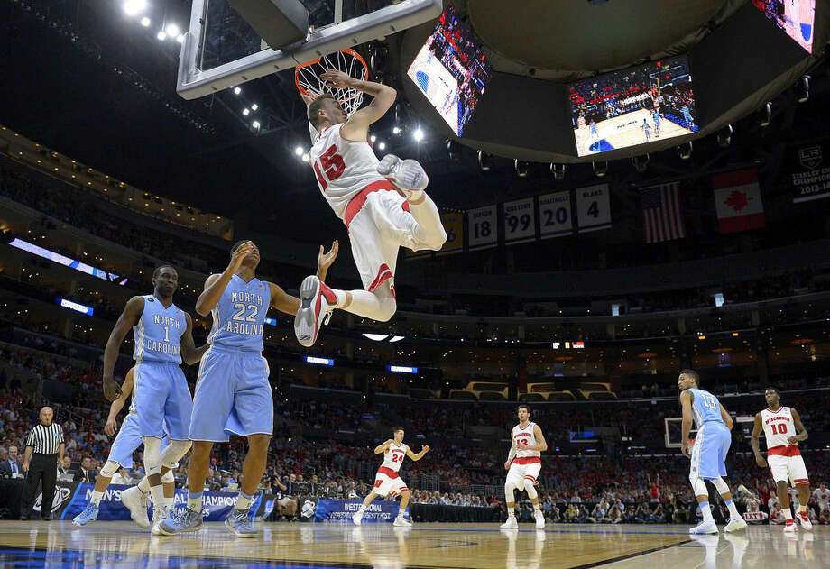Wisconsin forward Sam Dekker (15) dunks against North Carolina during the first half of a college basketball regional semifinal in the NCAA Tournament, Thursday, March 26, 2015, in Los Angeles. (AP Photo/Mark J. Terrill)