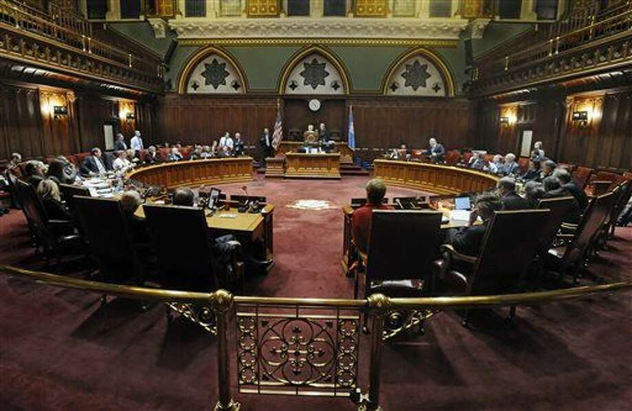 Connecticut state senators sit in a special session on a plan to close a projected $350 million budget deficit in the current fiscal year, at the state Capitol, Tuesday, Dec. 8, 2015, in Hartford, Conn. (AP Photo/Jessica Hill)