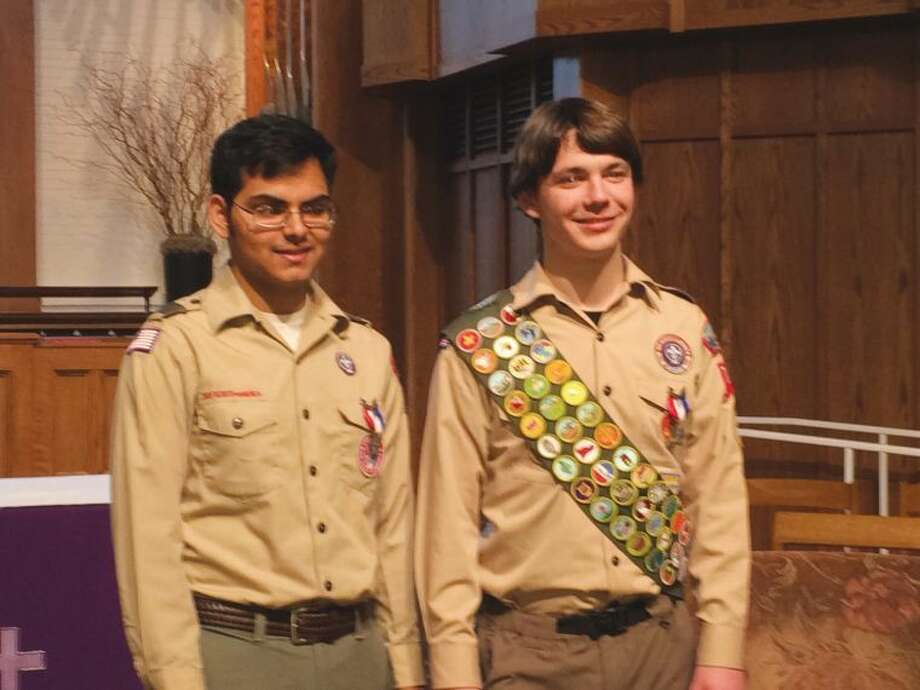Rama Siripuram (left) and Teddy Woods (right) were awarded their Eagle badges in front of the troop, friends and family. Additionally, state Rep. Gail Lavielle presented both young men with citations commemorating their achievement on behalf of the General Assembly.