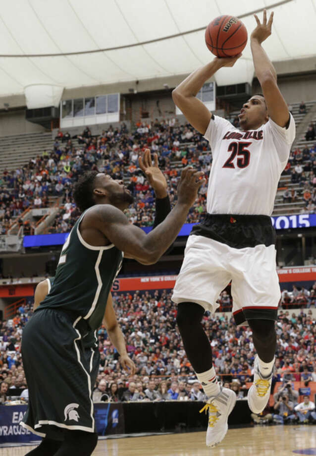 Louisville's Wayne Blackshear (25) shoots over Michigan State's Branden Dawson during the first half of a regional final in the NCAA men's college basketball tournament Sunday, March 29, 2015, in Syracuse, N.Y. (AP Photo/Seth Wenig)