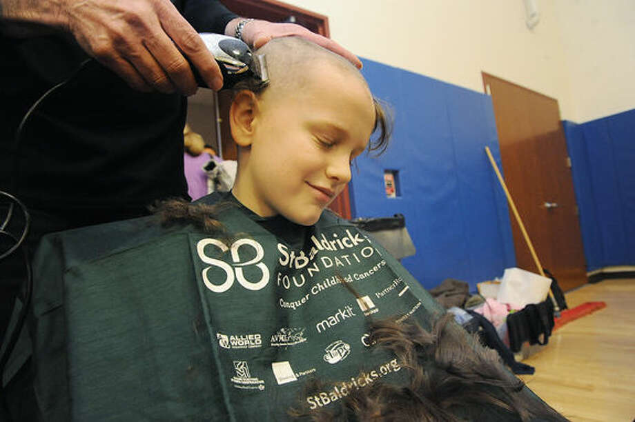 Patrick Farrelly 10 gets his head shaved at The 11th annual TeamBrent St. Baldrick's Celebration held at the Wesprt Weston YMCA in Westport on Sunday. Hour photo/Matthew Vinci