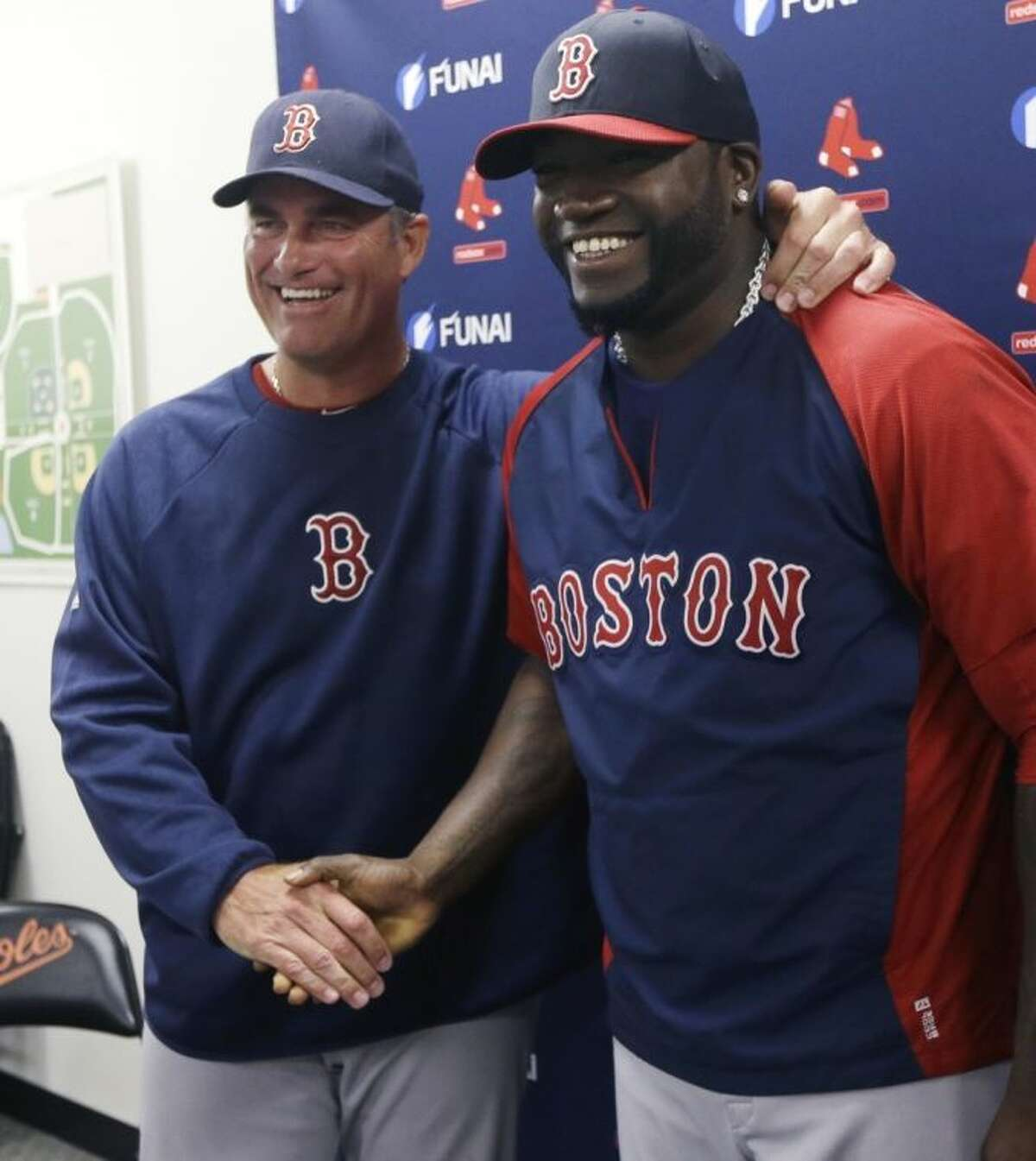 Boston Red Sox designated hitter David Ortiz, right, stands with manager John Farrell after a news conference regarding the agreement reached with the team that all but assures the popular slugger will finish his career in Boston, Monday, March 24, 2014 in Sarasota, Fla. Ortiz and the Red Sox agreed to a 2015 contract Sunday with options for the following two years. (AP Photo/Carlos Osorio)