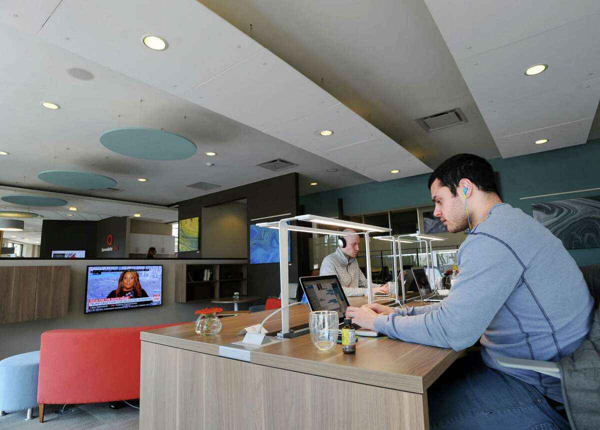 White Plains, N.Y., resident, Frank Vittorini, right, of the start-up company, uSTADIUM, a social sports app that connects fans, works in his Serendipity Labs workspace at 80 Theodore Fremd Ave., Rye, N.Y., Wednesday, April 6, 2016. Serendipity Labs, a coworking facility, is expanding to Stamford with ts third coworking location as part of a national franchise rollout at the former site of Eclisse.