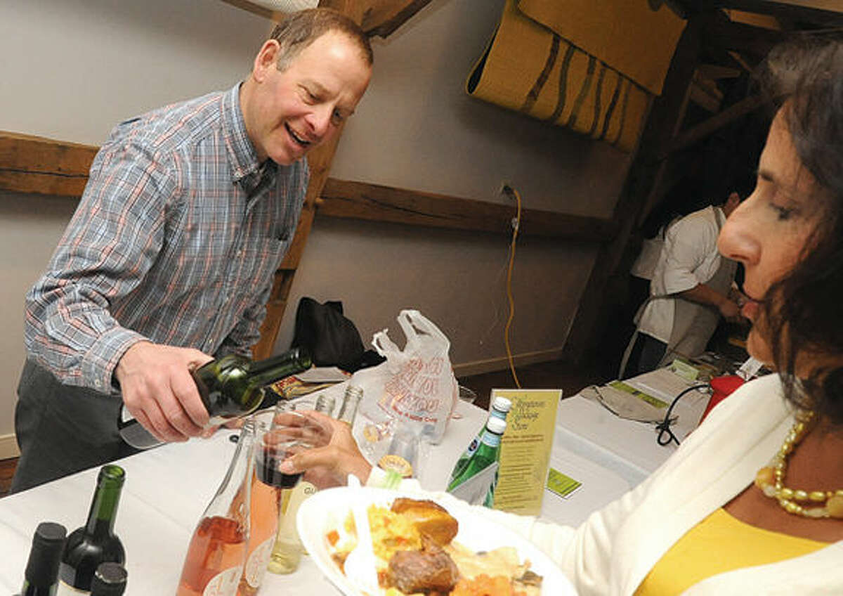 Steve DeNicola with Georgetown Package store serving wine at the 2015 Taste of Wilton held at the Wilton Historical Society on Monday.