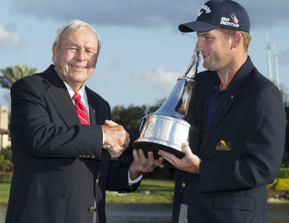 Arnold Palmer presents the trophy to Matt Every, right, after Every won the Arnold Palmer Invitational golf tournament at Bay Hill, Sunday, March 23, 2014, in Orlando, Fla. (AP Photo/Willie J. Allen Jr.)
