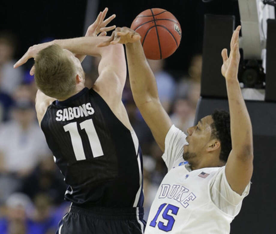 Duke's Jahlil Okafor (15) knocks the ball away from Gonzaga's Domantas Sabonis (11) during the first half of a college basketball regional final game in the NCAA Tournament Sunday, March 29, 2015, in Houston. (AP Photo/David J. Phillip)