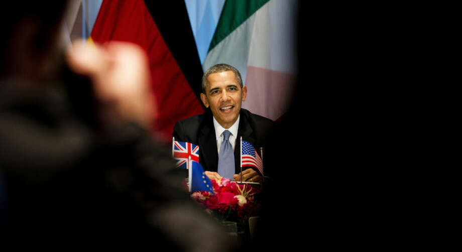 President Barack Obama, center rear, gathered with G7 world leaders in The Hague, Netherlands, Monday March 24, 2014, in the sidelines of the Nuclear security Summit. In a day of delicate diplomacy he sought to rally the international community Monday around efforts to isolate Russia following its incursion into Ukraine. Nuclear terrorism was the official topic as Obama and other world leaders streamed in to a convention center in The Hague for a two-day Nuclear Security Summit. But the real focus was on a hurriedly scheduled meeting of the Group of Seven industrialized economies to address the crisis in Ukraine on the sidelines of the nuclear summit. (AP Photo/Jerry Lampen, POOL)