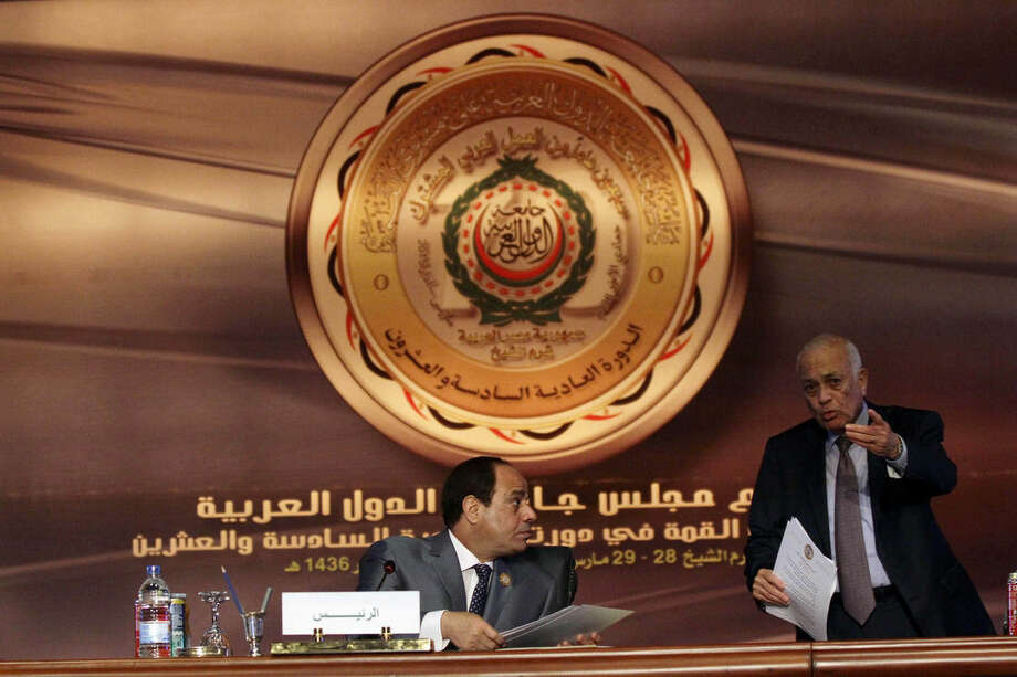 Egyptian President Abdel-Fattah el-Sissi, left, chairs a meeting of Arab foreign ministers as Arab League Secretary-General Nabil Elaraby makes a point, in Sharm el-Sheikh, South Sinai, Egypt, Sunday, March 29, 2015. Arab League member states at a summit in this Red Sea resort have agreed to form a joint inter-Arab military peacekeeping force. (AP Photo/Ahmed Abdel Fatah, El Shorouk Newspaper)