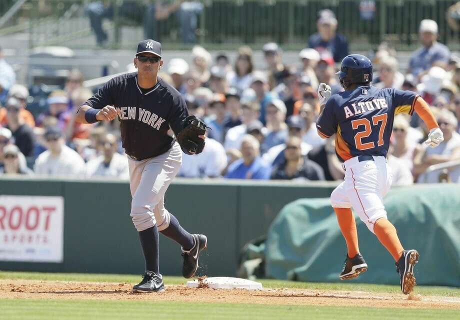 New York Yankees first baseman Alex Rodriguez makes the out on Houston Astros' Jose Altuve during the first inning of a spring training exhibition baseball game in Kissimmee, Fla., Sunday, March 29, 2015. (AP Photo/Carlos Osorio)