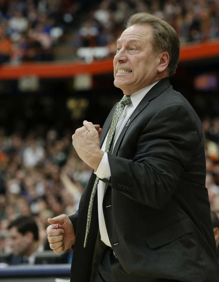 Michigan State head coach Tom Izzo reacts during the first half of a regional final against Louisville in the NCAA men's college basketball tournament Sunday, March 29, 2015, in Syracuse, N.Y. (AP Photo/Seth Wenig)