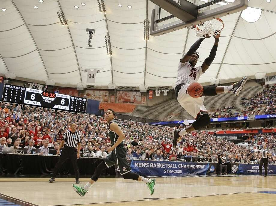 Louisville's Montrezl Harrell (24) dunks the ball in front of Michigan State's Bryn Forbes (5) during the first half of a regional final in the NCAA men's college basketball tournament Sunday, March 29, 2015, in Syracuse, N.Y. (AP Photo/Seth Wenig)