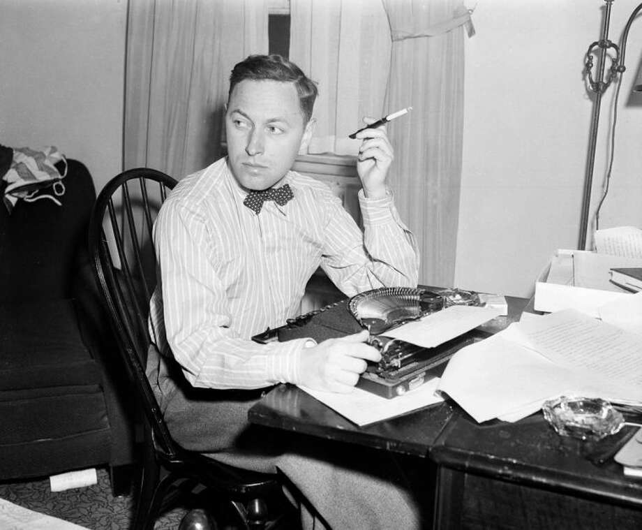 """FILE - This Nov. 11, 1940 file photo shows playwright Tennessee Williams at his typewriter in New York. """"Crazy Night"""", a work of short fiction by Williams will be printed in the spring issue of The Strand Magazine, a quarterly based in Birmingham, Mich. (AP Photo/Dan Grossi, File)"""
