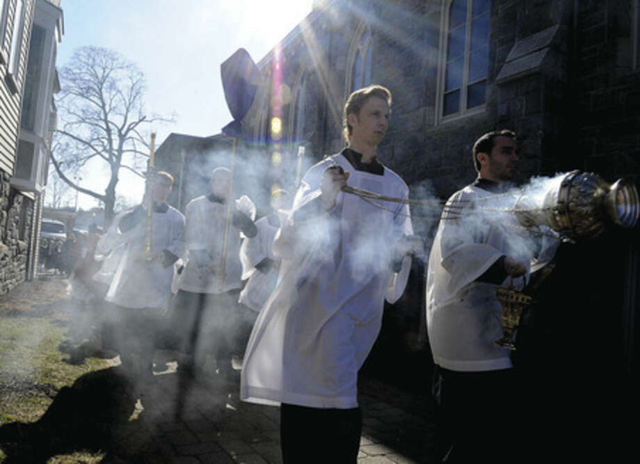 The procession Sunday at St. Mary Church for the Palm Sunday mass. Hour photo/Mattthew Vinci