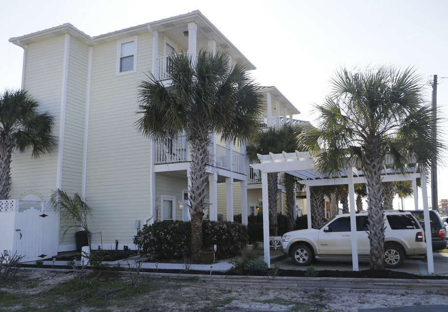 This Saturday, March 28, 2015 photo shows a rental home, foreground, along Thomas Drive in Panama City Beach, Fla. where seven people were injured in an early morning shooting during a house party. (AP Photo/News Herald, Heather Leiphart) MANDATORY CREDIT: NEWS HERALD, HEATHER LEIPHART