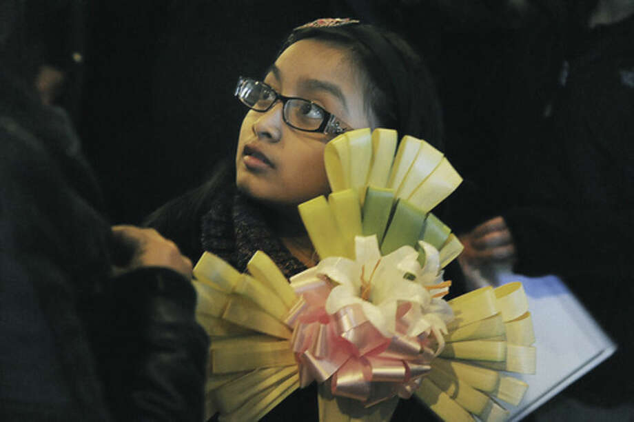 9 year old Shalyn Sachtqua at the Palm Sunday mass at St. Mary Church in Norwalk. Hour photo/Matthew Vinci