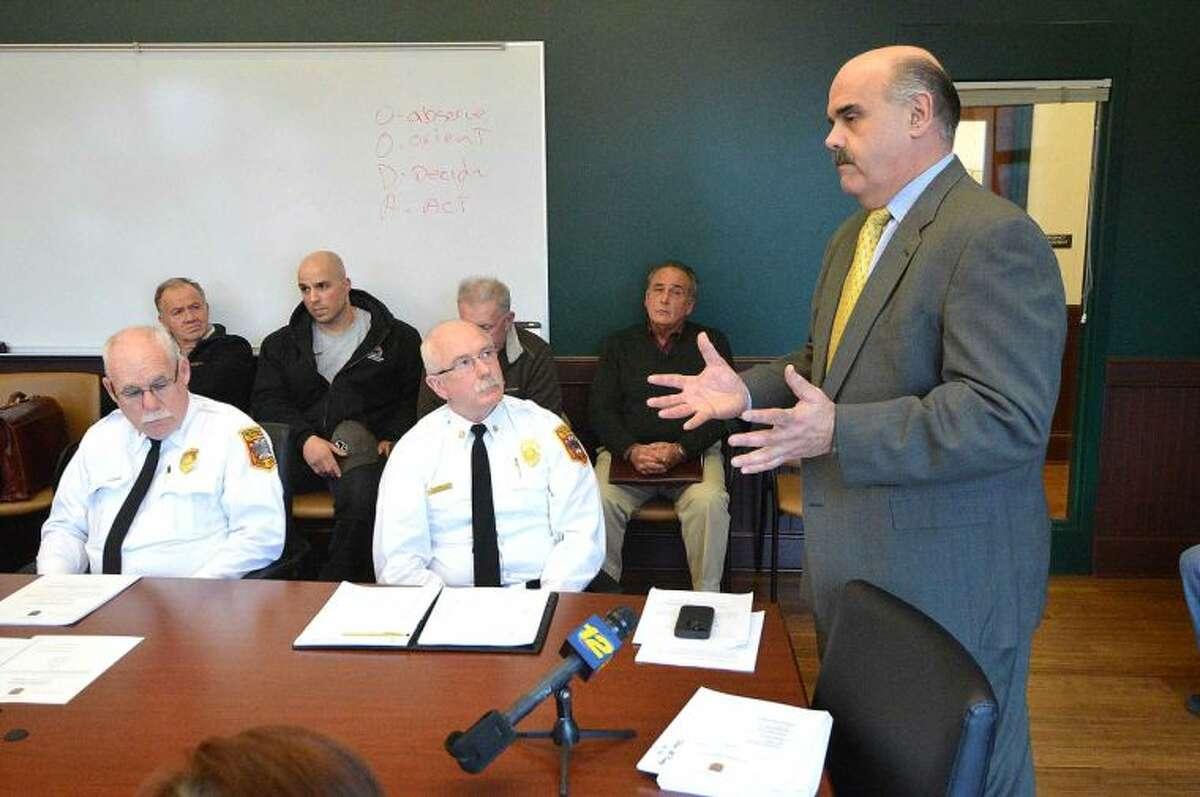 Hour Photo/Alex von Kleydorff Pete Romano speaks to the Fire Commission on behalf of Jason Penna