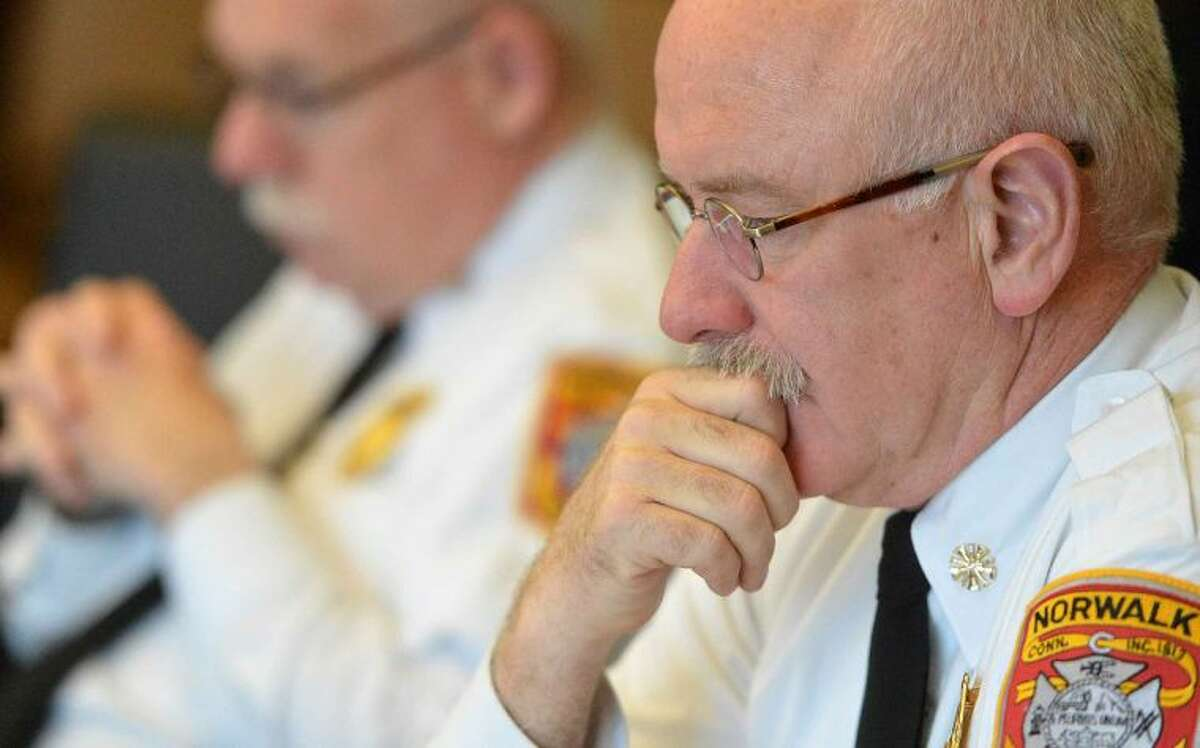 Hour Photo/Alex von Kleydorff Norwalk Fire Department Chief Denis McCarthy listens during a Fire Commission meeting to decide the status of Jason Penna as a firefighter
