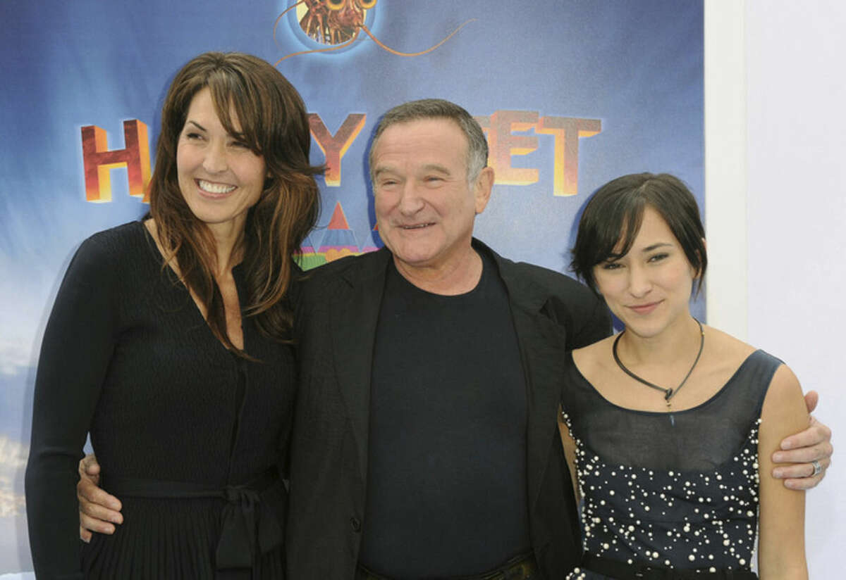 FILE - In this Nov. 13, 2011 file photo, Susan Schneider, from left, Robin Williams, and Zelda Williams arrive at the premiere of