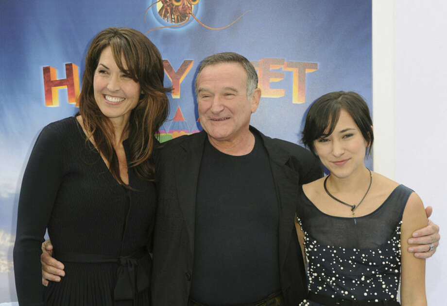 "FILE - In this Nov. 13, 2011 file photo, Susan Schneider, from left, Robin Williams, and Zelda Williams arrive at the premiere of ""Happy Feet Two"" at Grauman's Chinese Theater, in Los Angeles. Attorneys for Robin Williams' wife and children are headed to court in their battle over the late comedian's estate. The attorneys are scheduled to appear before a San Francisco probate judge on Monday, as they argue over who should get clothes and other personal items the actor kept at one his Northern California homes. In papers filed in December, Williams' wife, Susan, says some of the late actor's personal items were taken without her permission. She has asked the court to set aside the contents of the home she shared with Williams from the jewelry, memorabilia and other items Williams said the children should have. (AP Photo/Katy Winn, File)"